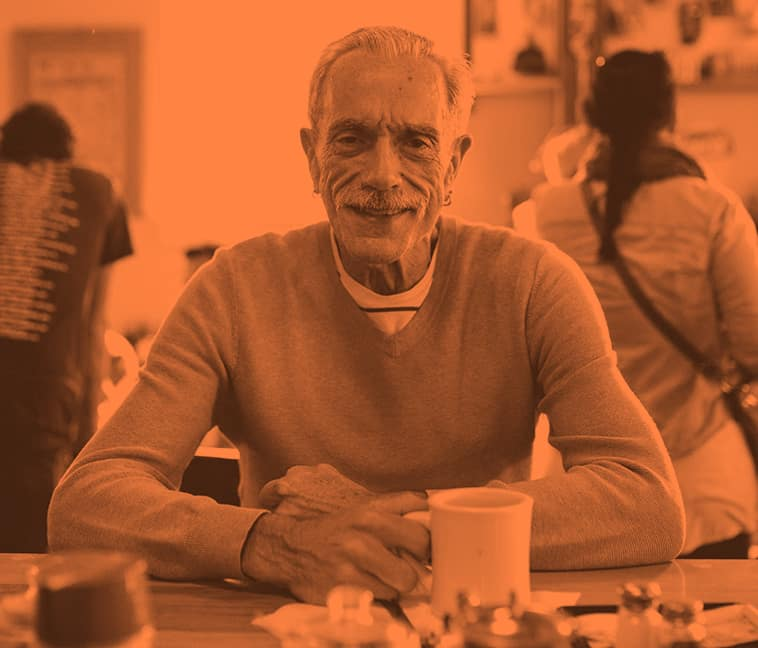 gay-man-at-senior-center-with-coffee-379x3242x