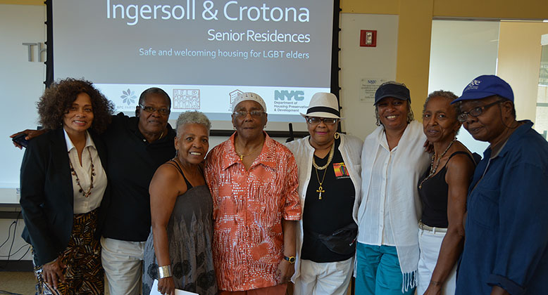 SAGE NYC Housing announcement with group of LGBT elders