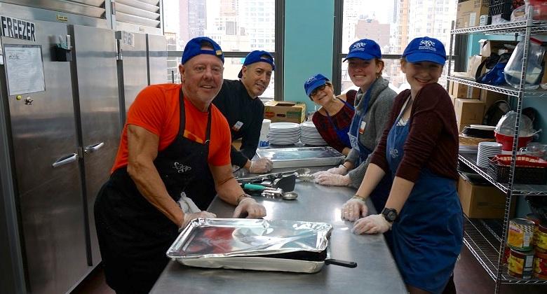 SAGE Volunteers in the kitchen preparing a meal