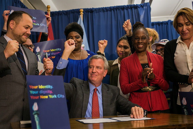NYC Mayor Bill de Blasio signs Gender X bill at SAGE, flanked by Corey Johnson, Chirlane McCray, and transgender older New Yorkers.
