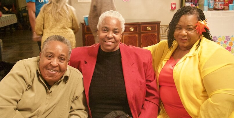 Three African American women pose at a SAGE event
