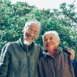 asian-couple-smiling-outside