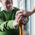 older-man-with-hands-on-a-cane