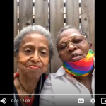 two-older-lesbian-women-with-rainbow-masks