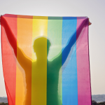 rainbow-flag-held-by-obscured-person